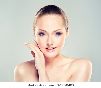 Beautiful Young Woman with Clean Fresh Skin close up . Skin care face . Cosmetology