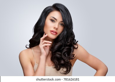 Beautiful Young Woman with Clean healthy curly hair