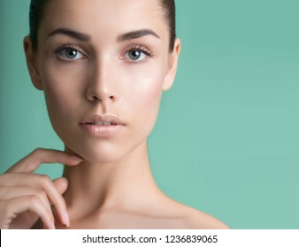 Beautiful young woman with clean perfect skin. Portrait of beauty model with natural nude make up and long eyelashes. Youth and skin care concept. Spa, skincare and wellness. Professional makeup.