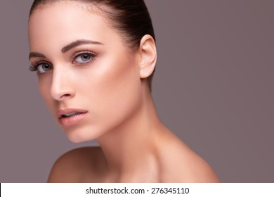 Beautiful young woman with clean skin of the face. Skin Care