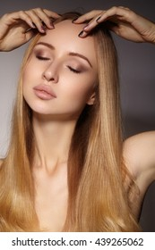 Beautiful young woman with clean skin, beautiful straight shiny hair, fashion makeup. Glamour make-up, perfect shape eyebrows. Portrait blondy. Beautiful smooth hairstyle. Keratine salon treatment