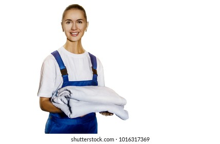 Beautiful young woman from cleaning service with towels