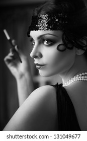Beautiful young woman close up portrait in retro flapper style headband bw Vogue style vintage
