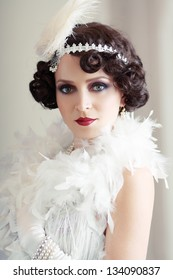 Beautiful young woman close up portrait in retro flapper style Vogue style vintage