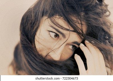 beautiful young woman close up portrait with the wind