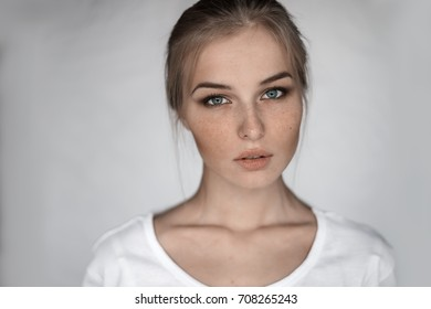 beautiful young woman close-up on a gray background