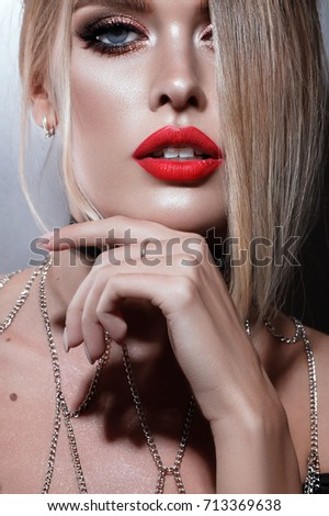 523274329bd Beautiful young woman close-up portrait with red lips and braces. Blonde  stylish hair
