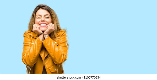 Beautiful young woman confident and happy with a big natural smile laughing