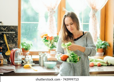 Beautiful young woman cooking in kitchen Prepare Food