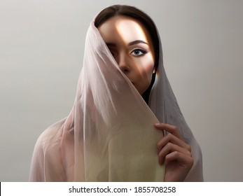 beautiful young woman covered her face. beauty woman in sunlight. fashion oriental style woman. ethnic people