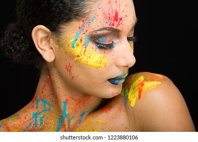 Beautiful Young Woman with Creative Splattered Makeup - Isolated on Black