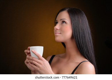 Beautiful Young Woman with cup of Coffee