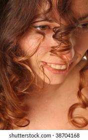 beautiful young woman with curly long hairs