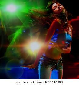 Beautiful young woman dancing in the nightclub.