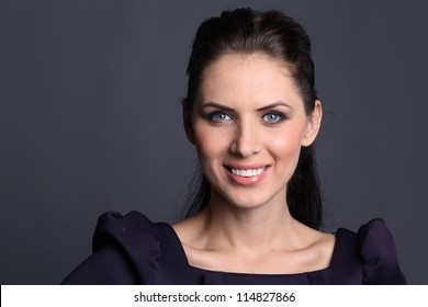 Beautiful young woman in dark background