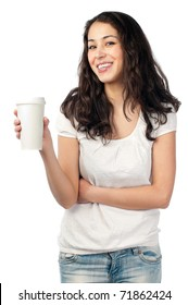 beautiful young woman with dark wavy hair smiling and looking into the camera, holding cup of coffee in her hand. Isolated on white background.