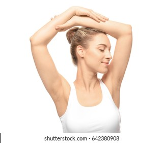Beautiful young woman with depilated armpits on white background