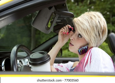 Beautiful young woman distracted while driving