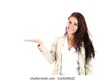 Beautiful young woman doing a hand gesture to one side against a white background