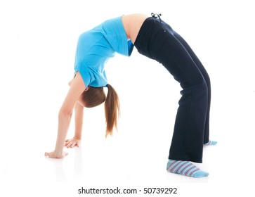 The beautiful young woman doing yoga exercise isolated on a white background