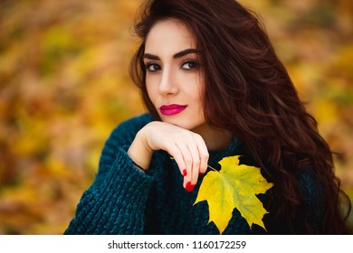 Beautiful young woman. Dramatic outdoor autumn portrait of sensual brunette female with long hair. Sad and serious girl