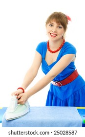 beautiful young woman dressed in retro clothes ironing the towels, against white background