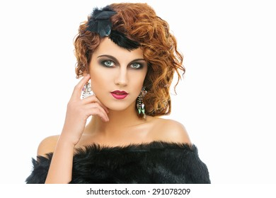 Beautiful young woman dressed in retro style with fancy hair and accessories. Isolated over white background.