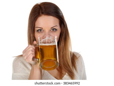 Beautiful young woman drinking beer on white background