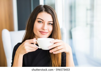 beautiful young woman drinking coffee with smile