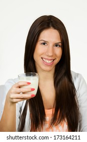 Beautiful young woman drinking milk, isolated on white background.