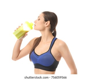 Beautiful young woman drinking protein shake on white background