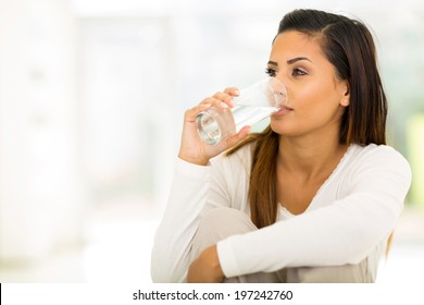 beautiful young woman drinking water in the morning
