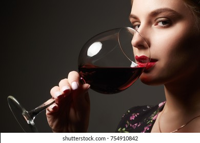 Beautiful young woman drinking wine.beauty girl with wineglass