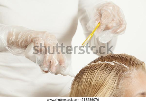 beautiful young woman dyeing hair