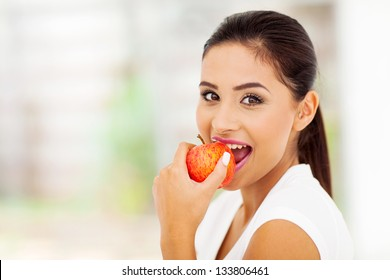 beautiful young woman eating an apple