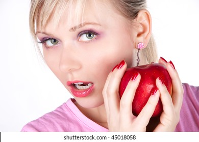 Beautiful young woman eating an apple. Isolated over white