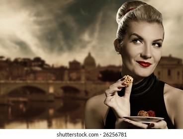 Beautiful young woman eating chocolate. Retro portrait