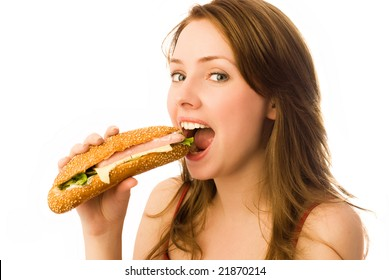 beautiful young woman eating a hot dog isolated against white background