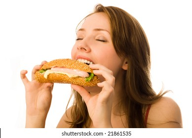 beautiful young woman eating a hot-dog isolated against white background