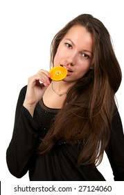 Beautiful young woman eating orange. Isolated over white