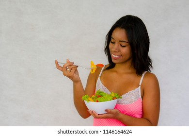 Beautiful young woman eating salad. care of the body and health. Lifestyle
