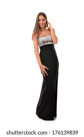 Beautiful young woman in elegant evening gown