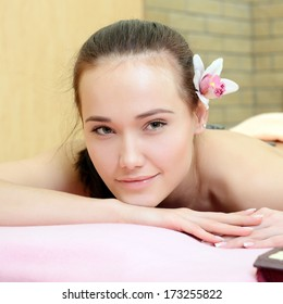 Beautiful young woman enjoy in spa salon, caucasian beauty model