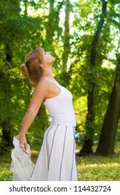 Beautiful young woman enjoying in nature
