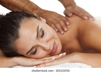 beautiful young woman enjoying the pleasant massage