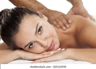 beautiful young woman enjoying the pleasant massage