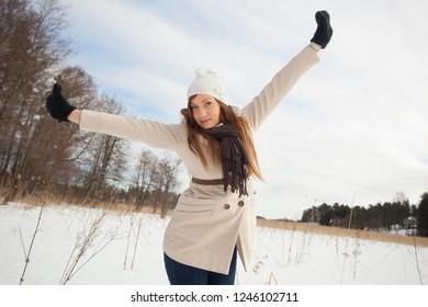 Beautiful young woman enjoying a winter day