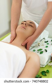 Beautiful Young Woman Enjoys Facial Massage in a Luxury Spa Resort Top view
