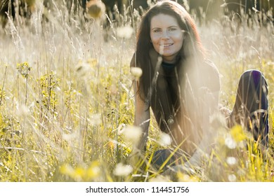 Beautiful young woman enjoys last warm day outside.