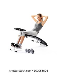 beautiful young Woman exercising abdomen muscles on bench